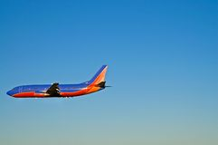 Passenger Airplane In Flight - 1. View of a colorful Boeing 737 passenger airliner in flight. Plenty of clear and open space for text Stock Images