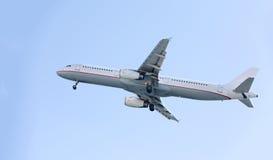 Passenger airplane during flight Stock Images