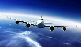 Passenger airplane flying above clouds Royalty Free Stock Images