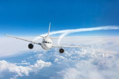 Free Passenger Airplane Flying At Flight Level High In The Sky Above The Clouds And Blue Sky Royalty Free Stock Photography - 131479907