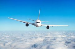 Free Passenger Airplane Flying At Flight Level High In The Sky Above The Clouds. View Directly In Front, Exactly. Royalty Free Stock Images - 113256149