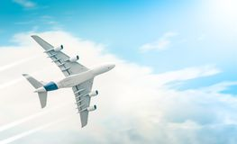 Passenger airplane flying in blue cloudy sky. Passenger airplane flying high and leaving trail in blue cloudy sky on sunny day. View from below. Comfortable and Royalty Free Stock Image