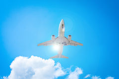 Passenger airplane flying in the blue sky with sunshine. It ls preparing to landing Royalty Free Stock Photography