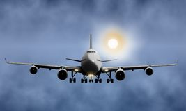 Passenger airplane flying in cloudy sky Royalty Free Stock Photography