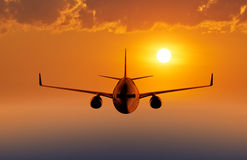 Passenger airplane flying in the sky Stock Image