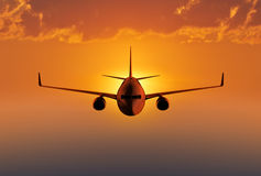 Passenger airplane flying in the sky Stock Photos