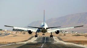 Passenger Airplane Landing On Runway. Stock Photo