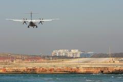 Passenger airplane landing on runway. Stock Images