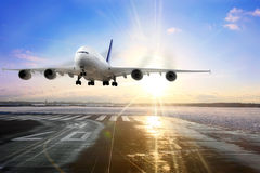 Passenger airplane landing on runway in airport. stock image