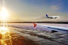 Passenger airplane landing on runway in airport. Evening Royalty Free Stock Photo