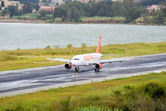 Passenger Airplane Landing To Active Runway Royalty Free Stock Photography
