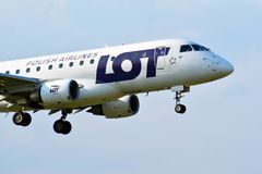 Passenger airplane LOT - Polish Airlines Embraer s flying from the runway of Warsaw Chopin Airport. Warsaw, Poland. 28 May 2018. Passenger airplane LOT - Polish royalty free stock photos