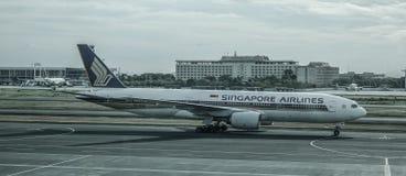 Passenger airplane at Manila Airport, Philippines stock photos