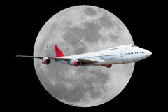 Passenger airplane with moon  on black background.  Royalty Free Stock Photography