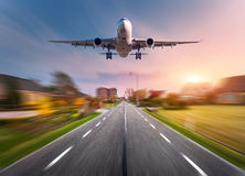 Passenger airplane with motion blur effect Royalty Free Stock Photos