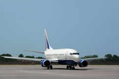 Passenger airplane move on runway Stock Photo