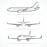 Passenger airplane silhouettes, contours, outlines Royalty Free Stock Photography