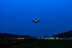 Passenger Airplane take off at night Royalty Free Stock Images