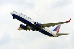 Passenger airplane takeoff from active runway Stock Photos