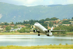 Passenger airplane takeoff from active runway. KERKIRA, GREECE- SEPTEMBER 16: Air Mediterranee passenger airplane taking off from active runway at  Kerkira Stock Images
