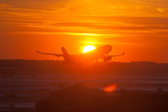 Passenger Airplane Taking Off. Passenger airliner taking off from an airport at sunset Royalty Free Stock Image