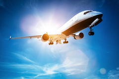 Passenger airplane taking off, sunny blue sky. Royalty Free Stock Photography