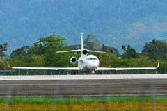 Passenger airplane taxiing on runway of airport. Langkawi, Malaysia - Mar 31, 2019. Dassault Falcon 8X reg. N444FJ taxiing on runway of Langkawi International stock photo