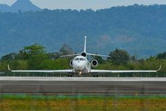 Passenger airplane taxiing on runway of airport. Langkawi, Malaysia - Mar 31, 2019. Dassault Falcon 8X reg. N444FJ taxiing on runway of Langkawi International royalty free stock image