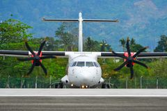 Passenger airplane taxiing on runway of airport. Langkawi, Malaysia - Mar 31, 2019. 9M-LMU Malindo Air ATR 72-600 taxiing on runway of Langkawi International royalty free stock photography