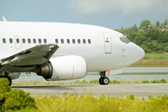 Passenger airplane waiting for takeoff clearance on the runway Stock Photos