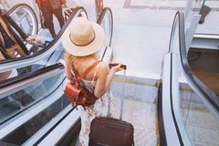 Passenger in airport or modern train station, woman commuter. With luggage royalty free stock photography