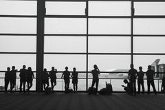 Passenger in airport. Silhouette of people walking Stock Photos