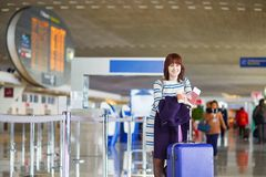 Passenger at the airport with take away coffee Stock Image