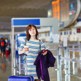 Passenger at the airport with take away coffee Royalty Free Stock Photos