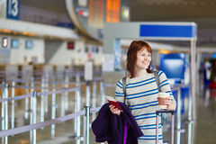 Passenger at the airport with take away coffee Stock Photo