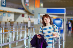 Passenger at the airport with take away coffee Royalty Free Stock Image