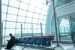 Passenger awaits flight. A man awaits for his flight at an airport terminal in Dubai, UAE stock photos
