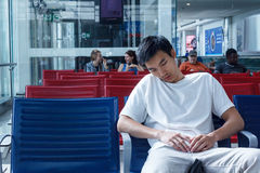 Passenger awaits flight. A man naps as he awaits for his flight at an airport terminal in Dubai, UAE royalty free stock photos