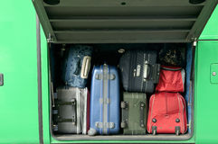Passenger baggage. Passenger baggage stacked in bus trunk Royalty Free Stock Image