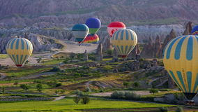 Passenger balloons floating over Cappadocia, Turkey stock video footage