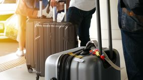 Passenger with big roller luggage standing on the line waiting for taxi queue at taxi parking lot at airport arrival terminal.  stock footage