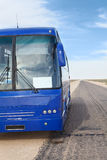 Passenger blue bus on the roadside Royalty Free Stock Image
