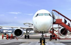 Passenger boarding airplane from front view Stock Photo