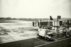 Passenger boarding bridge waiting for the plane at large airport Stock Image