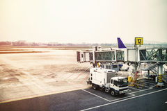 Passenger boarding bridge waiting for the plane at large airport Royalty Free Stock Image
