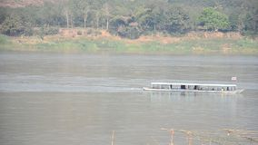 Passenger boat bring travelers people visit and travel in Mekong river stock video footage