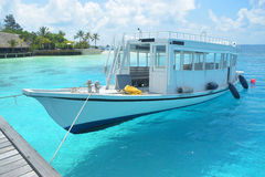 Passenger boat in clear waters Stock Photo