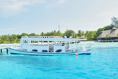 Passenger boat in clear waters Stock Images