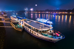 Passenger Boat with Fireworks in Background stock photography