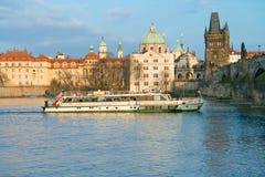 Passenger boat goes under Charles Bridge in Prague Royalty Free Stock Photo